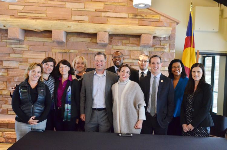 A group photo is taken at a bill signing ceremony on the CU Boulder campus.