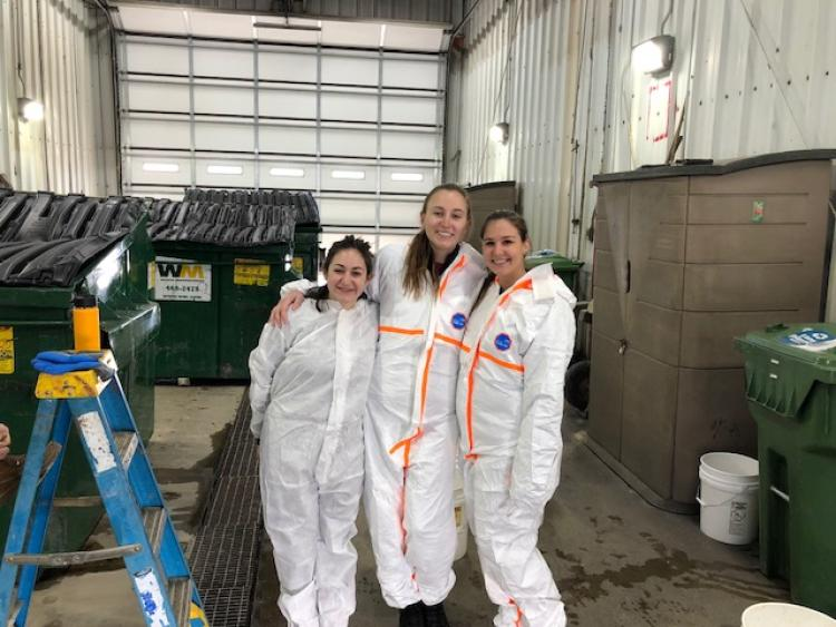 Students pose for photo during waste audit at Vail Resorts