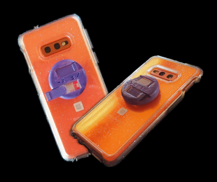 Two smartphones with CheckPls accessories.