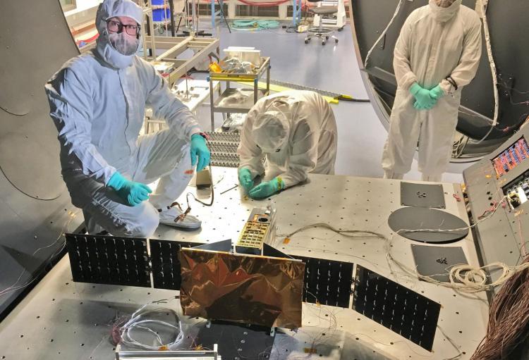 Researchers prep the CSIM CubeSat for testing