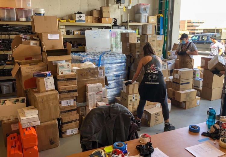 Volunteers from Team Rubicon load up CU Boulder PPE donations on Friday, April 13, 2020. (Sam Bogan/CU Boulder)