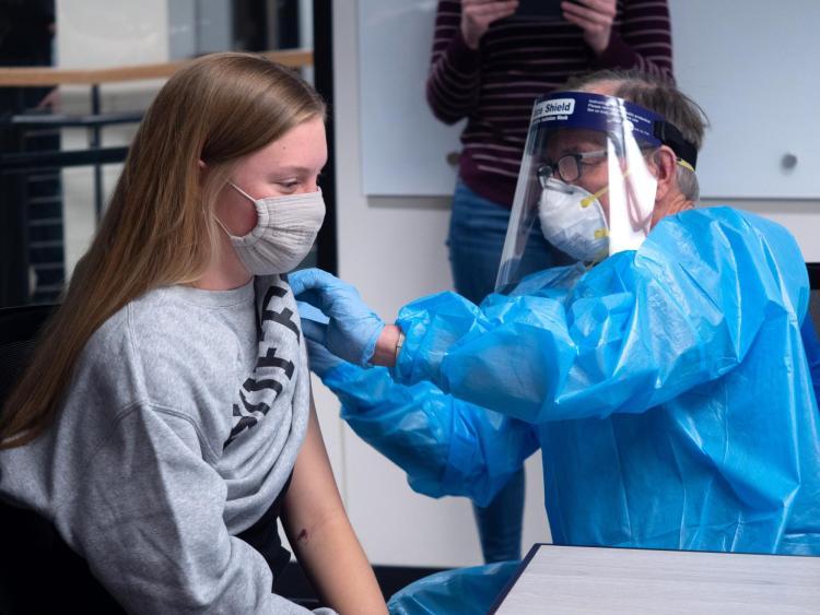 CU Boulder student Olivia Parsons getting a COVID-19 shot