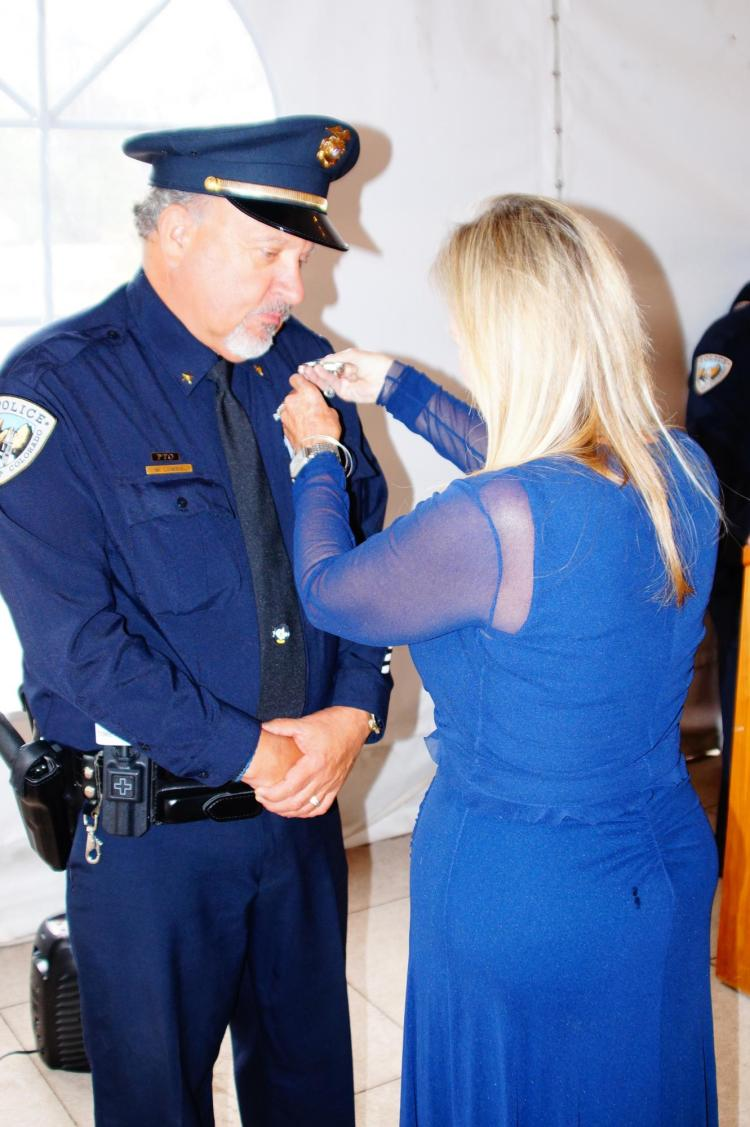 Commander Michael Lowry is pinned by his wife Elizabeth