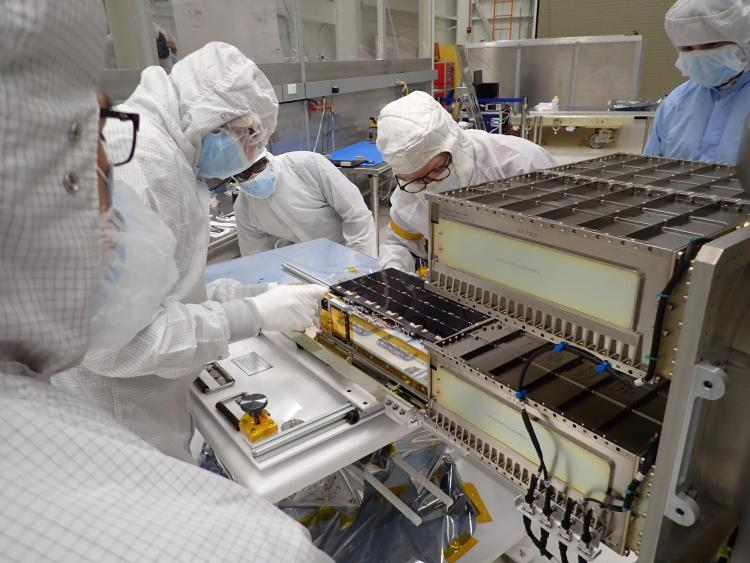 A team installs CUTE into its launch system in a clean lab
