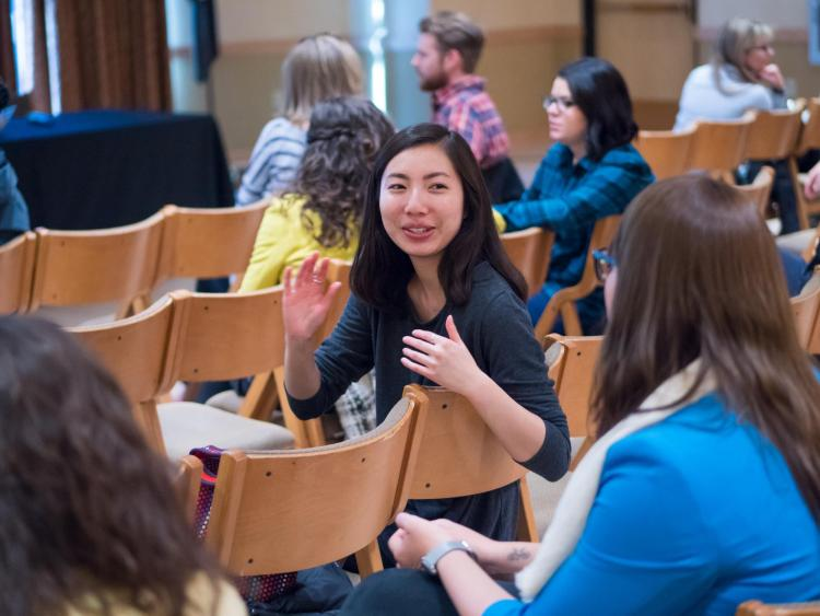 Diversity and Inclusion Summit attendees talk in small groups