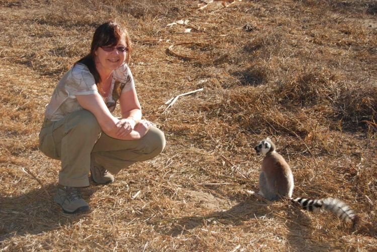 Michelle Sauther poses next to a ring-tailed lemur