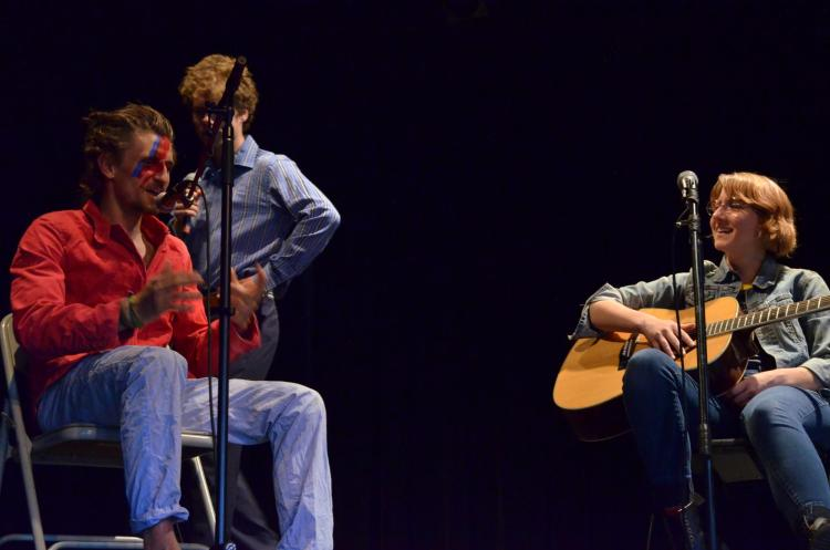 Students perform musical comedy on stage