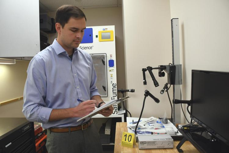 Will Heskett in the CUPD Property/Evidence and CSI lab (photo provided)