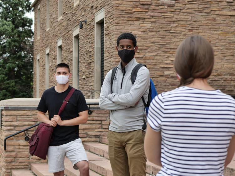 students safely socializing on campus