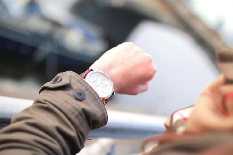 Person checks watch