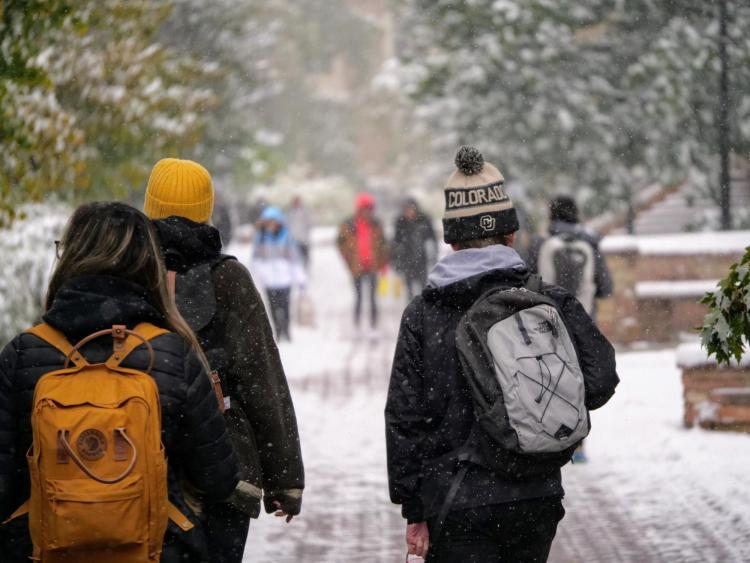 Campus community members walking on a snowy campus