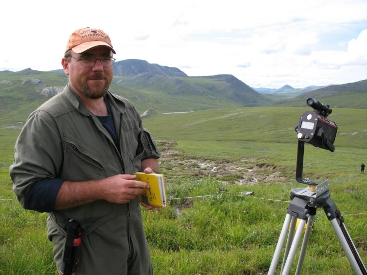 Michael Gooseff surveying the degradation of permafrost in Alaska.