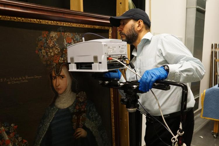 Gerardo Gutiérrez runs a scan on a Renaissance-era portrait of a nun.