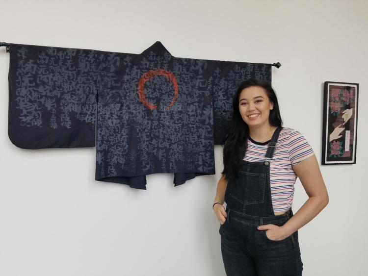 Haley Takahashi with one of the kimonos she made for the exhibit