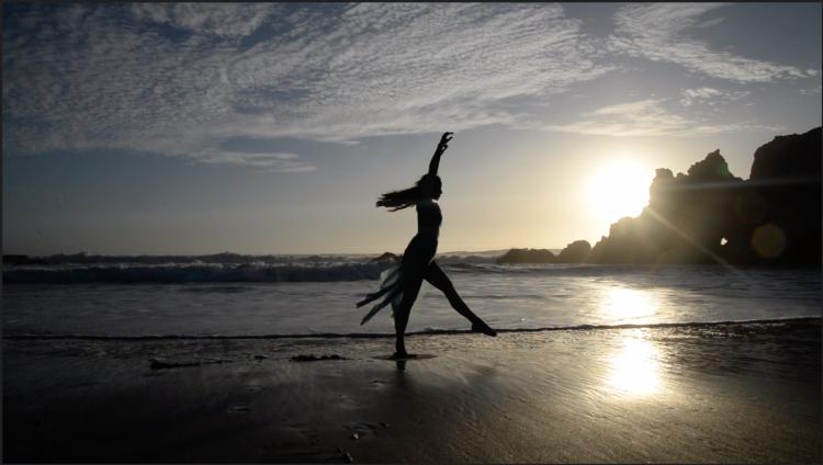 Rae Lewark performing on beach