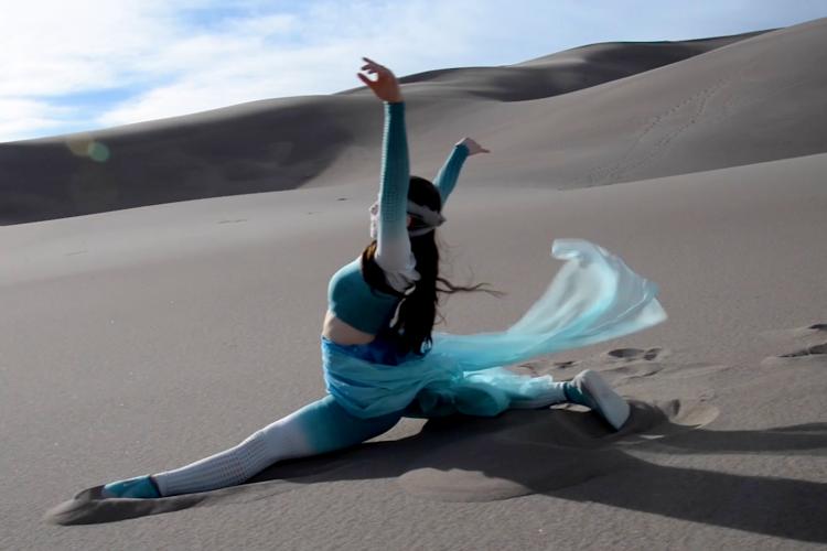 Rae Lewark performing in desert