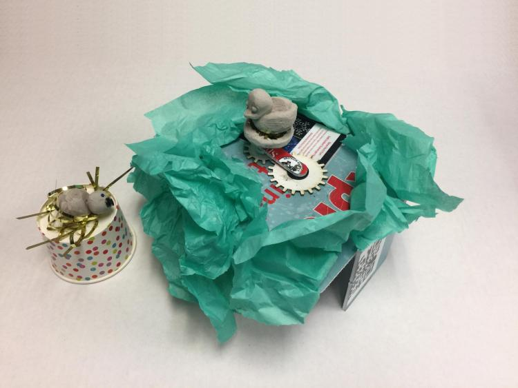 Paper robot created by student at Boulder Public Library makeathon