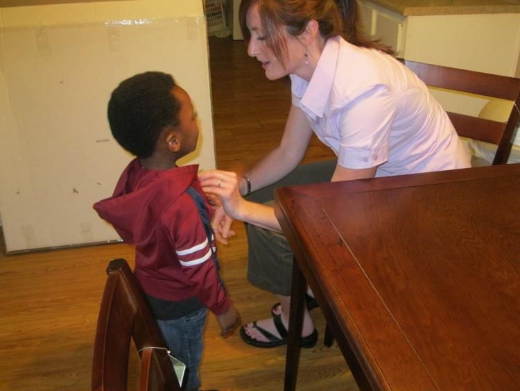 Lori Peek helping a child after Katrina