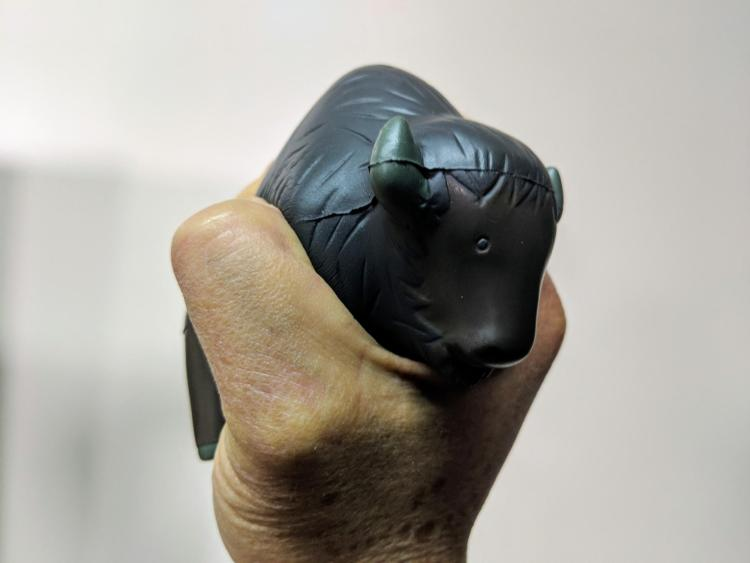 Person squeezes a Buff-shaped stress ball