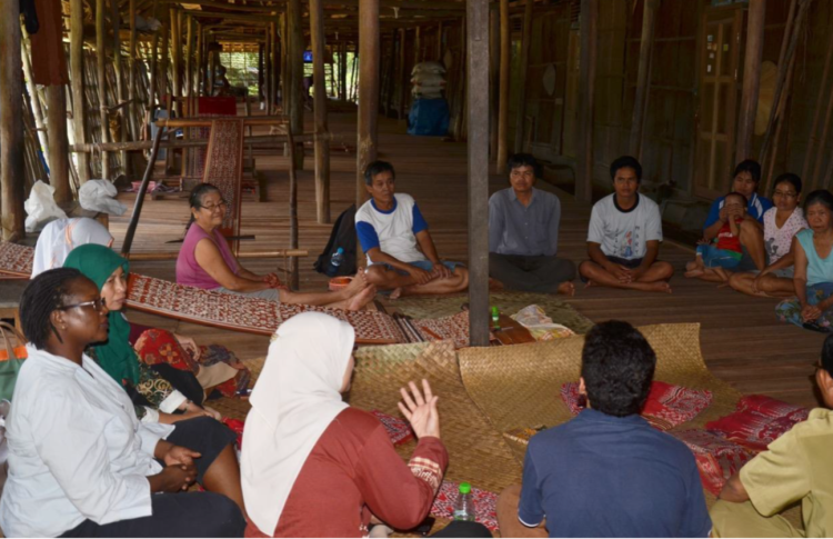 Forest users in Indonesia take part in a simulation to test whether paying cash for conservation works.
