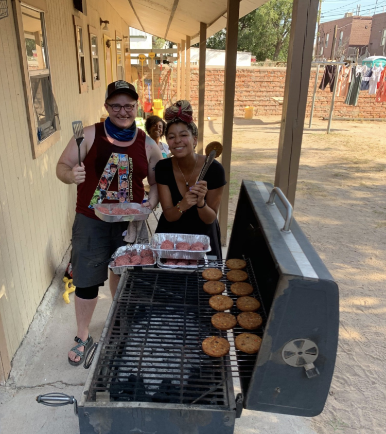 The INVST team grills burgers at Annunciation House