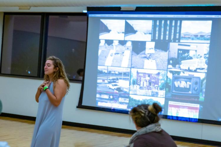 INVST student Adi Sadeh talks about her summer experiences at an event in Boulder