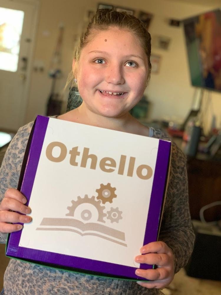 Isabelle Harris holds Othello game