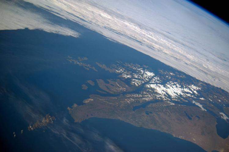This panoramic image from Feb. 14, 2014, shows parts of Chile and Argentina from the International Space Station (ISS). Tierra del Fuego and Cape Horn are shown here, with the Atlantic Ocean in the foreground and the Pacific Ocean across the top of the image. (Photo provided by NASA)