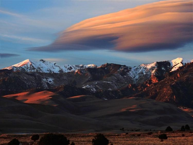 Lenticular clouds, which look a bit like a layer cake, form over Great Sand Dunes National Park in Colorado.