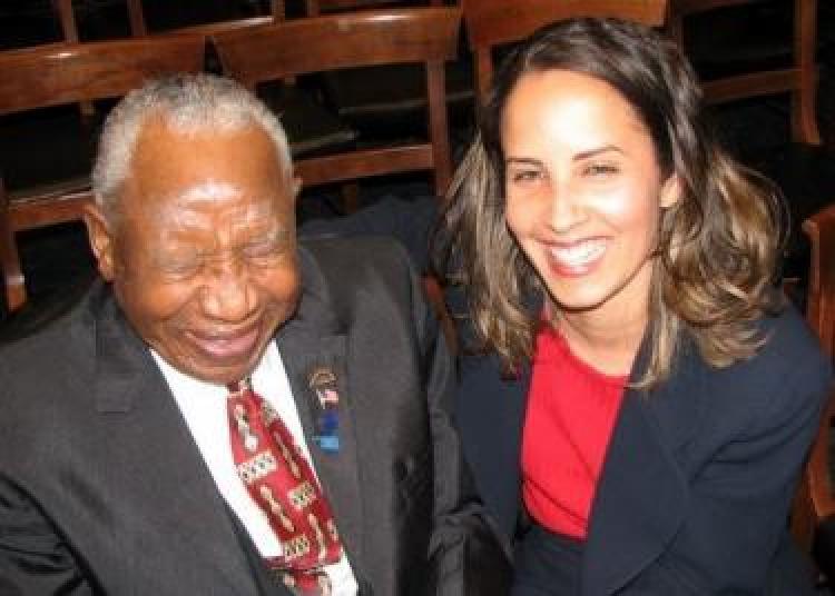 Professor Malveaux with Tulsa massacre survivor Otis Clark