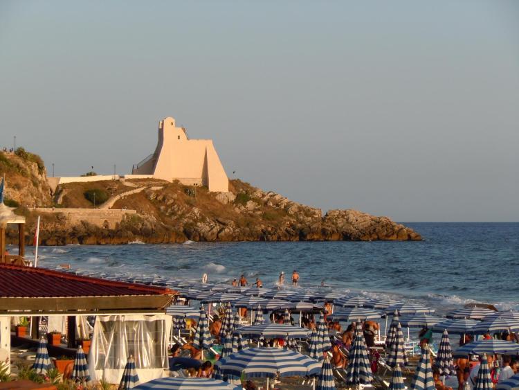 Homo sapiens families enjoy the beach in Sperlonga, Italy, not far from Grotta dei Moscerini.