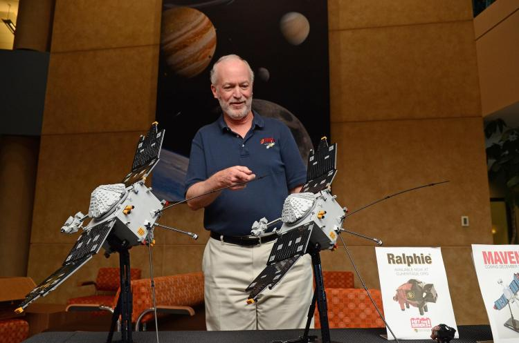 Bruce Jakosky looks at two Lego models of the MAVEN spacecraft