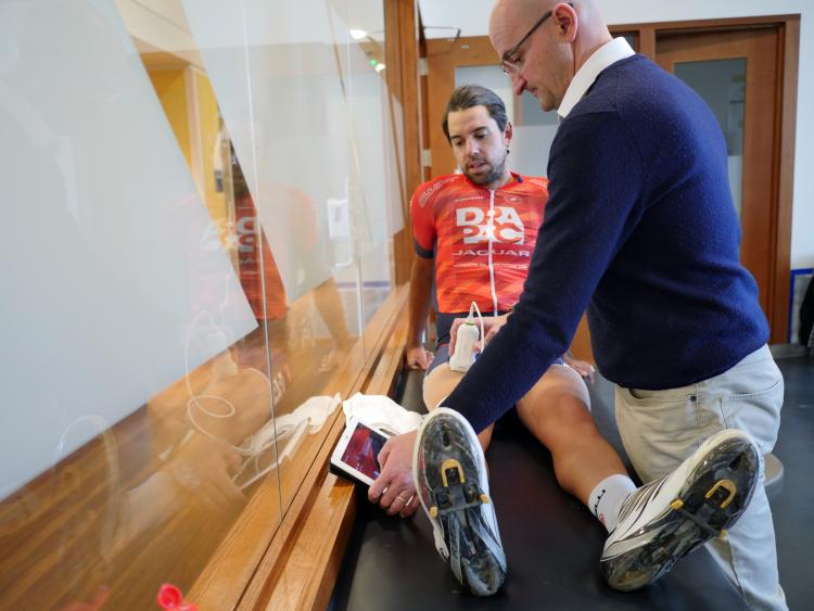 Inigo San Millan conducts a MuscleSound test on a cyclist