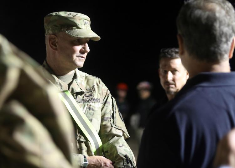 An army major general speaks with Army North responders assigned to the incident command post during exercise Sudden Response 16-2 at Fort Hood, Texas.