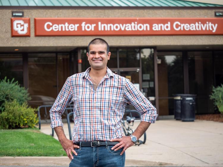 Sidney D'Mello stands in front of the Center for Innovation and Creativity building on the CU Boulder campus.