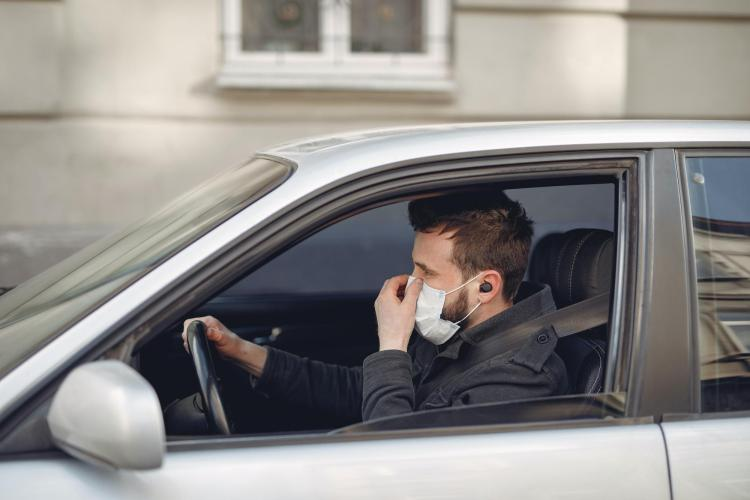 Man driving with mask
