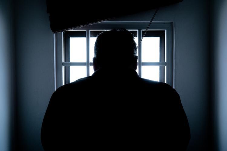 A shadowed image of a prisoner
