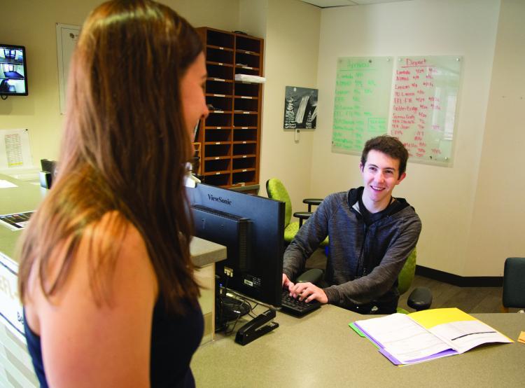 Student talks with residence hall advisor.