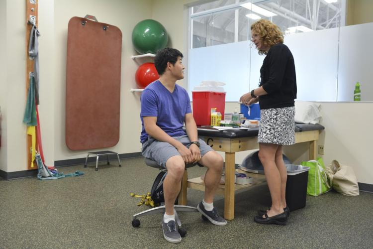Students attend a free flu shot clinic at the CU Boulder Rec Center.