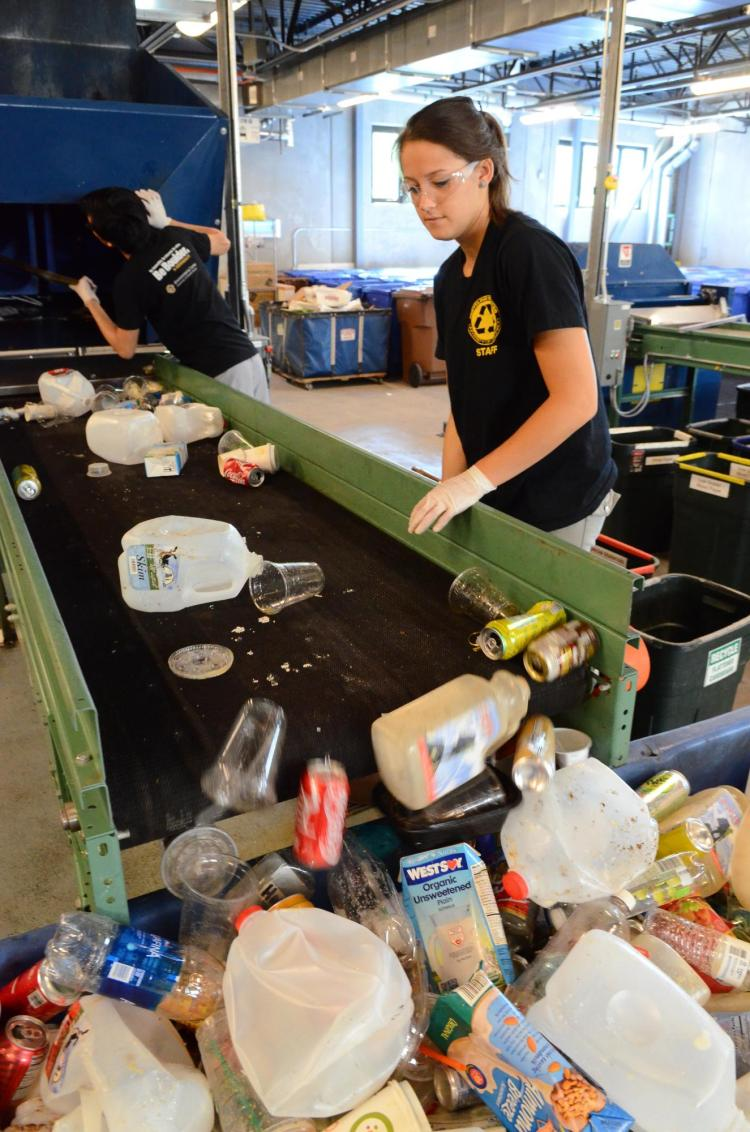Students sort through recycled material in the Recycling Center at CU Boulder