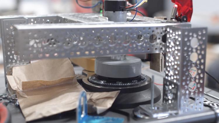 Close up of safecracking robot