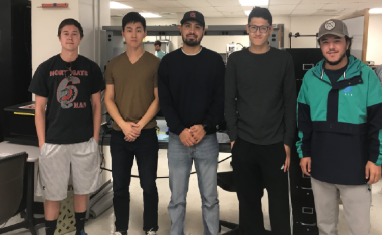 Five engineering students on the team who are developing Pulse, an advanced sensory system for the blind