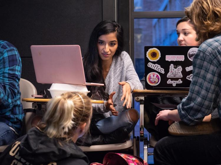Serene Singh works with fellow classmates in a poli sci thesis class