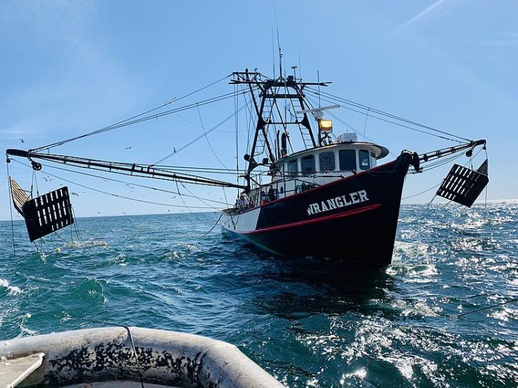 A shrimp boat sails off the coast of Oregon