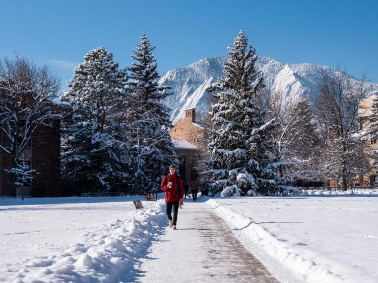 Student walking on snowy campus