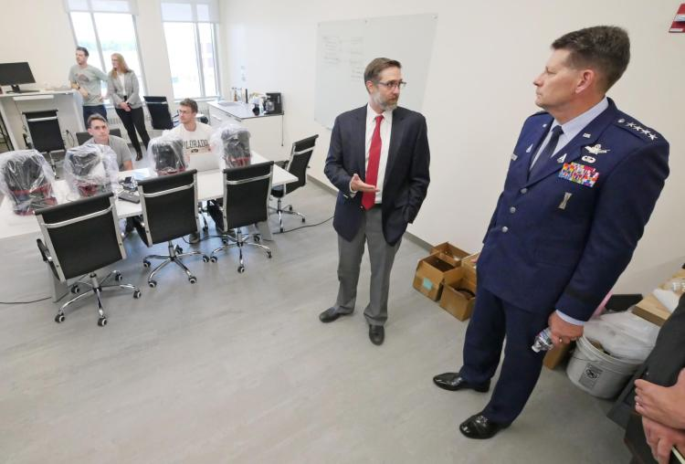Gen. Thompson speaks to Professor Marcus Holzinger in his lab on campus