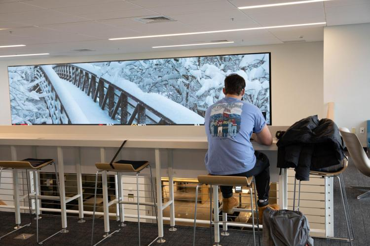 Students at the Leeds School of Business practice safe protocols while studying indoors.