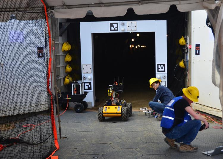 MARBLE team members ready a Husky robotic vehicle to enter Edgar mine.