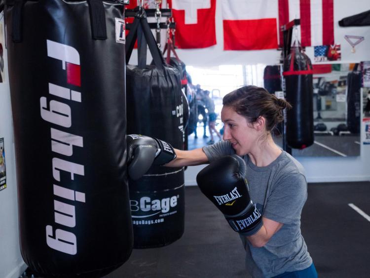 Tessie Dawson takes a swing at a punching bag