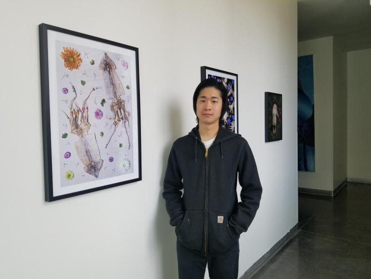 Thomas Yi with his framed food photography